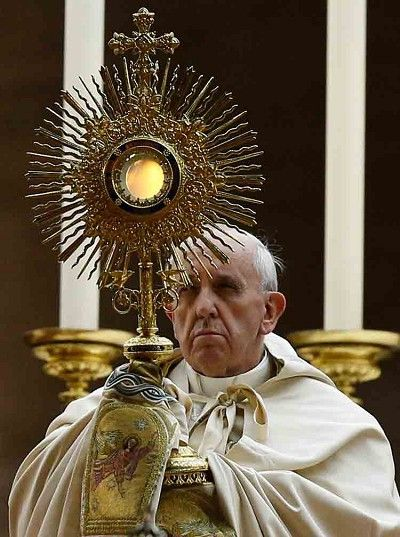 Pope Francis holding a symbol of the Sun